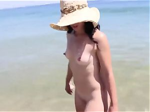 big bootie cougar naked on a beach