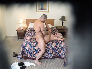 insatiable Nina Elle fucks her stud at the motel