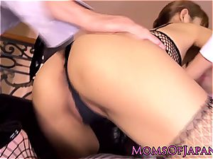 japanese mummy in fishnets plays with her taut rosy poon