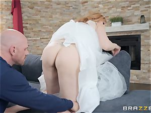 Redheaded Lauren Phillips bouncing on a large dick