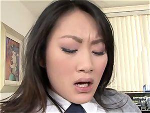 Evelyn Lin clad in a schoolgirls uniform