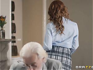 Redheaded hotty Ella Hughes showered in cum